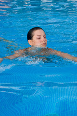 A young woman swimming