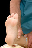 Woman having Ankle Massage poster