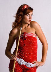 Redhead girl holding a pool cue