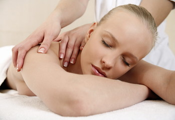 Young woman enjoying a massage