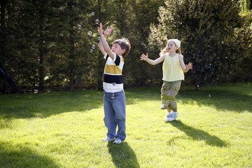 Boy and girl playing in the yard