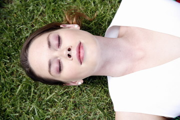 Portrait of woman lied down on the grass