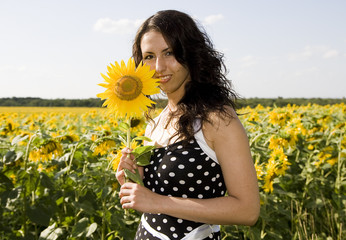 portrait of cute girl with sunflower