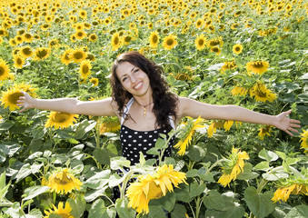 happy girl in field of sunflowers