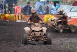 Fototapety Quad bike racing in dirt and mud