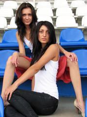 Sexy models posing at the stadium