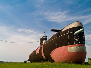 Submarine on green field