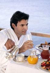 Man having breakfast on hotel terrace