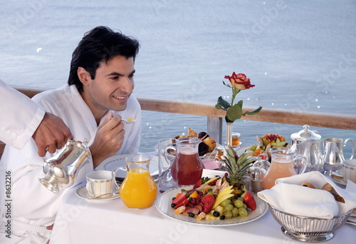 Man having breakfast on hotel terrace