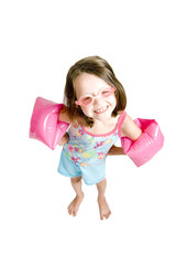 little girl with goggles and missing teeth