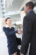 Diverse Business Man and Woman Handshake
