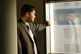 sad business man looking through window blinds - Fine Art prints