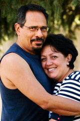 Adult Hispanic Couple Embracing Portrait