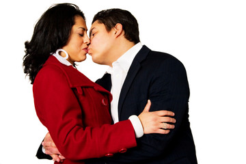 Young Hispanic Couple Kissing Isolated