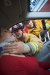Firefighters helping an injured woman in a car - 8652859