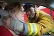 Firefighters helping an injured woman in a car - 8652868