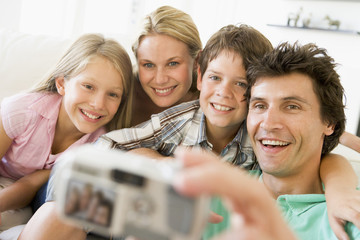 Family taking self portrait with digital camera