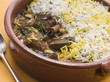 Pot of Lamb Biryani with a spoon