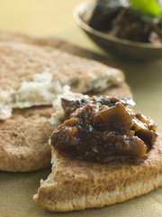 Pot of Brinjal Chutney with Naan Bread