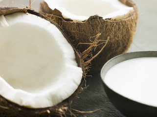 Dish of Coconut Milk with a Split Fresh Coconut