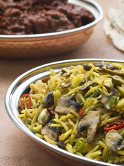 Dish of Mushroom Pilau Rice with Beef Madras