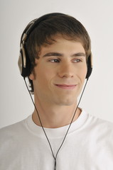 """""""Young male adult;listening to music with earphones"""""""