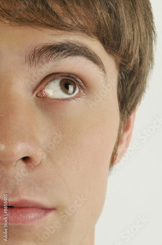 """Young male adult face;looking up"""