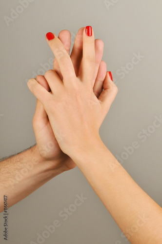 Young adult couple holding hands