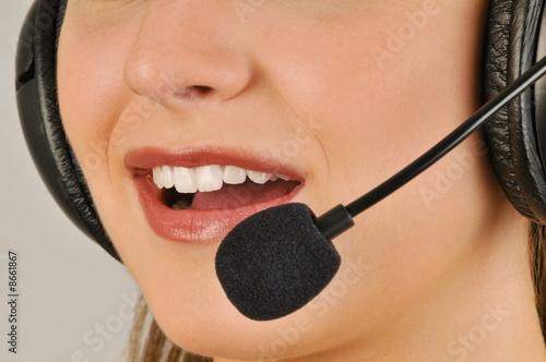 Female young adult mouth with microphone headset