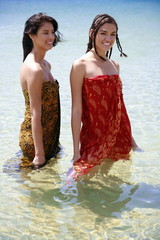 Two young women posing in water