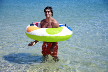 Man in the water with inflatable life ring