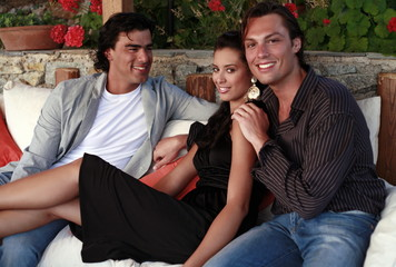 Two men and a woman on a couch