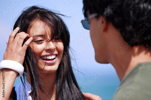 Closeup of young woman looking at man