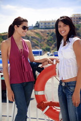 Two young women at ferry dock