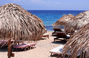 Grass beach umbrellas
