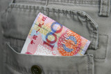 A bunch of 100 Chinese yuan notes stuffed in the back pocket. poster