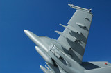 large scale replica fighter jet against blue sky poster