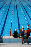 Three swimmers ready to dive - 8686006