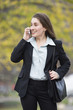 View of a business woman talking on the phone and smiling.