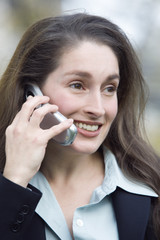 Close up of a smiling business woman talking on the phone.