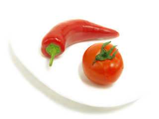Hot chili pepper and fresh tomato