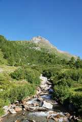 High mountain scene, river, blue sky, Switzerland, Ticino