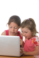Sisters Playing on Laptop