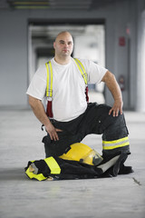 Portrait of a Fireman kneeling.