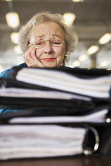 View of a senior woman tensed with workload.
