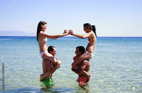 Group of friends playing in the water
