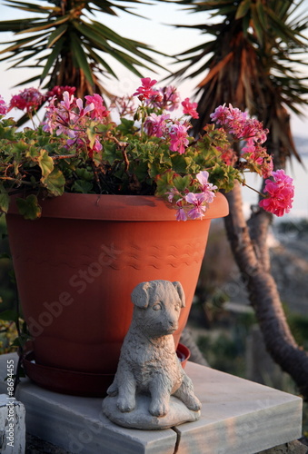 Flower pot with dog statue
