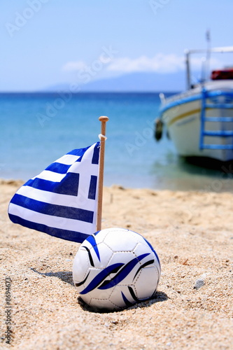 Ball and Greek flag on beach