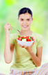 young beautiful woman eating healthy food - salad
