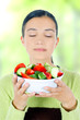 young beautiful woman eating healthy food - salad